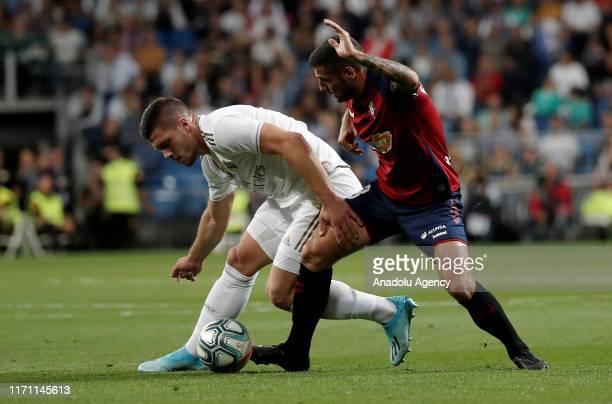 Luka Jovic of Real Madrid vies with Fran Merida of Osasuna during the La Liga match between Real Madrid and Osasuna at the Santiago Bernabeu Stadium...