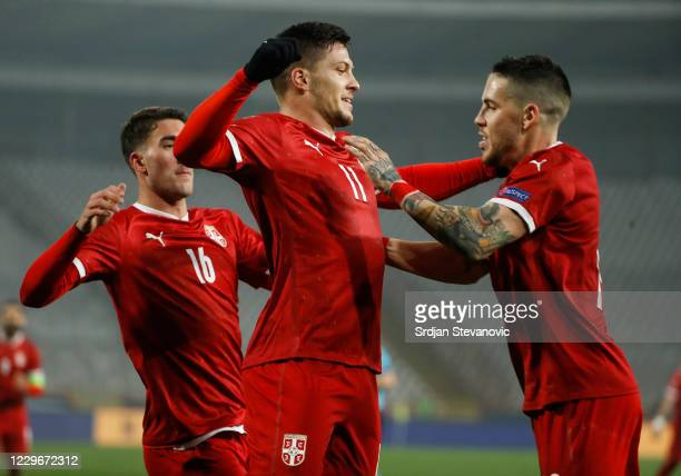 Luka Jovic of Serbia celebrates after scoring a goal with Dusan Vlahovic and Mihailo Ristic during the UEFA Nations League group stage match between...
