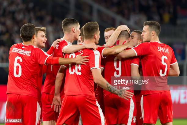 Luka Jovic of Serbia celebrates after scoring his team's first goal with team mates during the International Friendly match between Germany and...