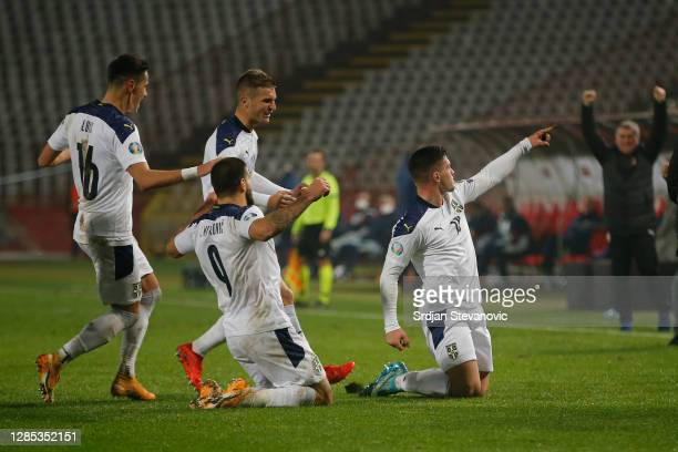 Luka Jovic of Serbia celebrates after scoring his team's first goal during the UEFA EURO 2020 Play-Off Final between Serbia and Scotland at Rajko...
