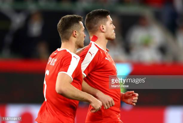 Luka Jovic of Serbia celebrates with team mate Uros Spajic of Serbia after scoring their team's first goal during the International Friendly match...
