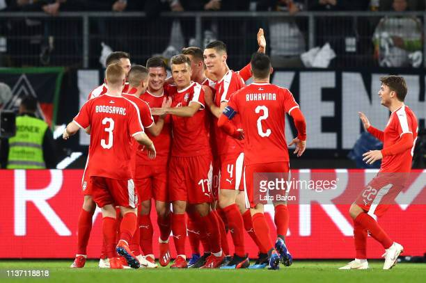 Luka Jovic of Serbia celebrates with team mates after scoring their team's first goal during the International Friendly match between Germany and...