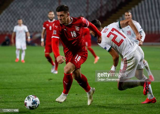 Luka Jovic of Serbia in action against Barnabas Bese of Hungary during the UEFA Nations League group stage match between Serbia and Hungary at Rajko...