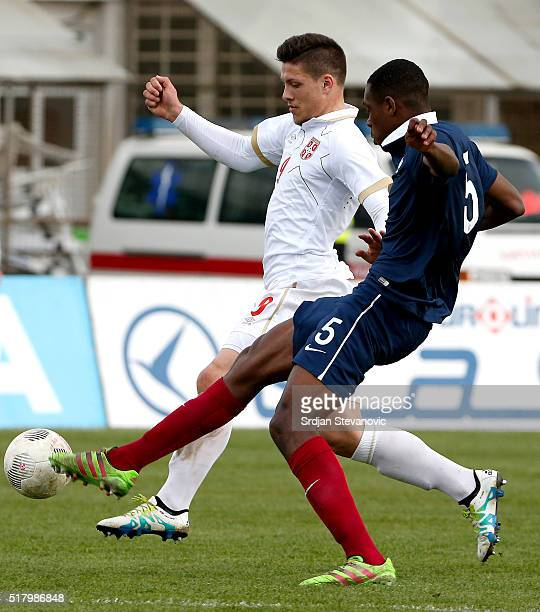 Luka Jovic of Serbia in action against Issa Diop of France during the UEFA European U19 Championship Elite Round Group 7 match between Serbia and...