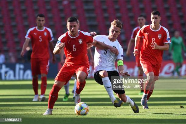 Luka Jovic of Serbia is challenged by Philipp Lienhart of Austria during the 2019 UEFA U21 Group B match between Serbia and Austria at Nereo Rocco on...