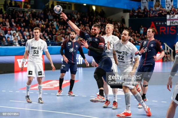 Luka Karabatic of Paris Saint Germain is shooting the ball against Ole Rahmel of THW Kiel during the Champions League match between Paris Saint...