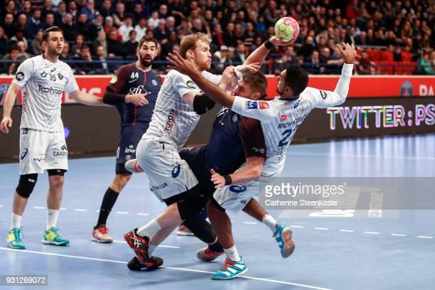 Luka Karabatic of Paris Saint Germain is trying to shoot the ball against Jonas Truchanovicius of Montpellier Handball and Melvyn Richardson of...