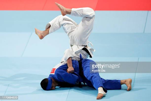 Luka Maisuradze of Georgia and Saeid Mollaei of Iran compete in the Men's 81kg bronze medal bout on day four of the World Judo Championships at the...