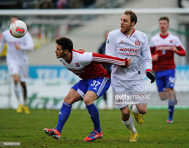 Luka Marino Odak of Unterhaching is challenged by Timo Furuholm of Halle during the third Bundesliga match between SpVgg Unterhaching and Hallescher...