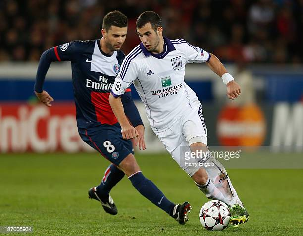 Luka Milivojevic of Anderlecht turns away from Thiago Motta of PSG during the UEFA Champions League Group C match between Paris Saint Germain and RSC...