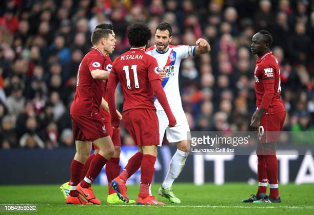 Luka Milivojevic of Crystal Palace and Mohamed Salah of Liverpool argue during the Premier League match between Liverpool FC and Crystal Palace at...