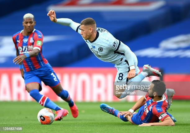 Luka Milivojevic of Crystal Palace and Ross Barkley of Chelsea clash during the Premier League match between Crystal Palace and Chelsea FC at...