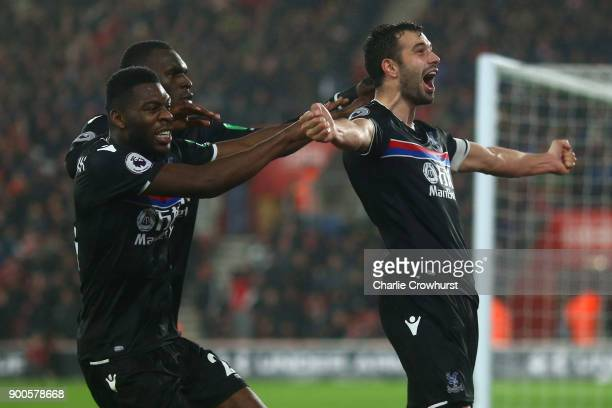Luka Milivojevic of Crystal Palace celebrates after scoring his sides second goal with his Crystal Palace team mates during the Premier League match...