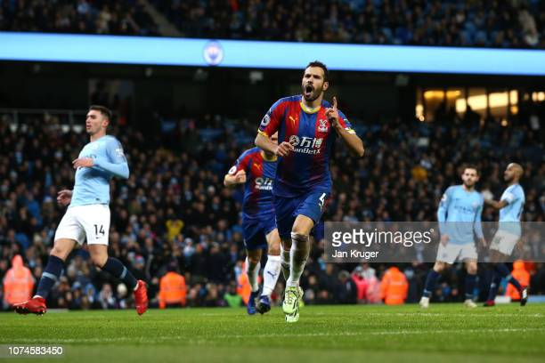 Luka Milivojevic of Crystal Palace celebrates after scoring his team's third goal during the Premier League match between Manchester City and Crystal...