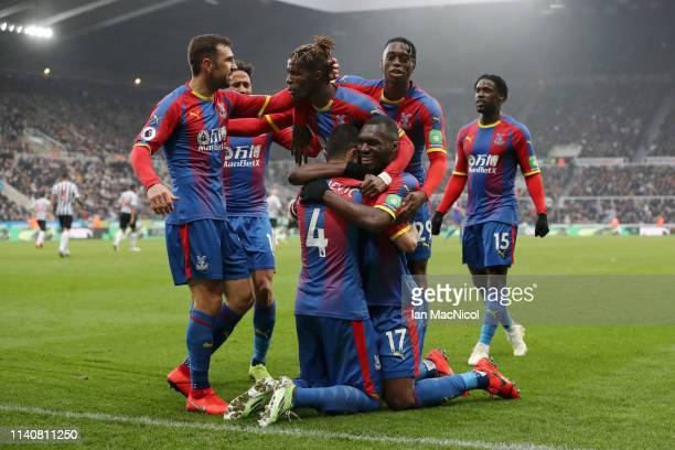 Luka Milivojevic of Crystal Palace celebrates after scoring his team's first goal from the penalty spot wit his team mates during the Premier League...