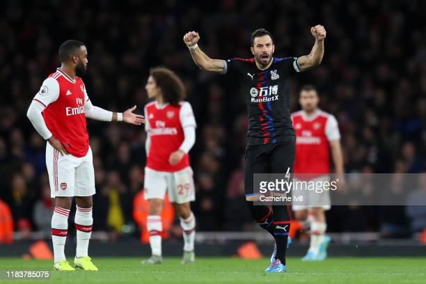 Luka Milivojevic of Crystal Palace celebrates after scoring his team's first goal from the penalty spot during the Premier League match between...