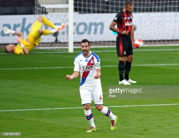Luka Milivojevic of Crystal Palace celebrates after scoring his team's first goal during the Premier League match between AFC Bournemouth and Crystal...