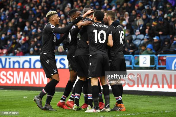 Luka Milivojevic of Crystal Palace celebrates scoring his side's second goal with team mates during the Premier League match between Huddersfield...