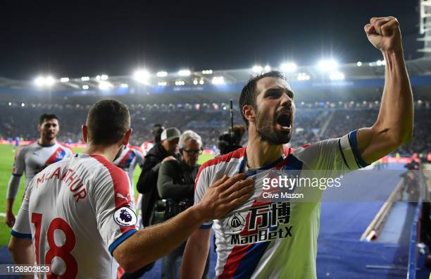 Luka Milivojevic of Crystal Palace celebrates with teammates after scoring his team's third goal during the Premier League match between Leicester...