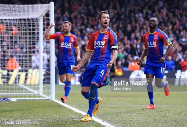 Luka Milivojevic of Crystal Palace celebrates with teammates after scoring his team's first goal during the Premier League match between Crystal...