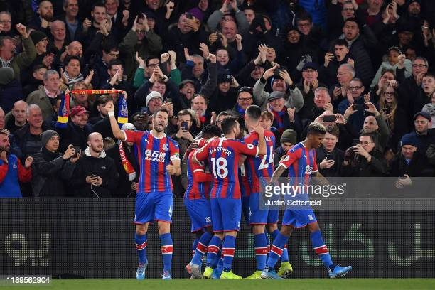 Luka Milivojevic of Crystal Palace celebrates with teammates after his teams first goal during the Premier League match between Crystal Palace and...
