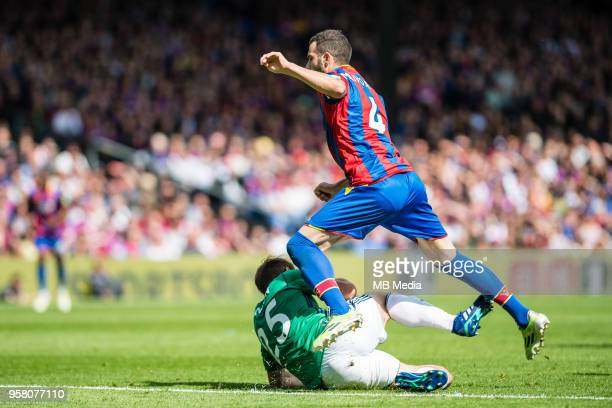 Luka Milivojevic of Crystal Palace fouled by Craig Dawson of WBA during the Premier League match between Crystal Palace and West Bromwich Albion at...