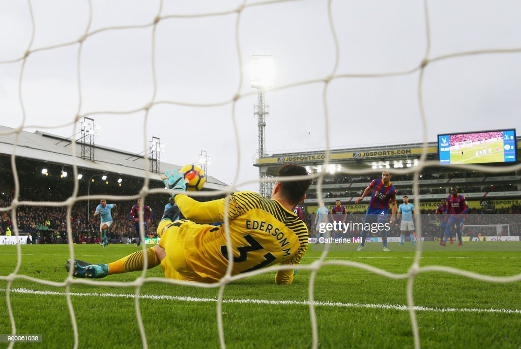 Luka Milivojevic of Crystal Palace has is penalty by Ederson of Manchester City during the Premier League match between Crystal Palace and Manchester City at Selhurst Park on December 31, 2017 in London, England.