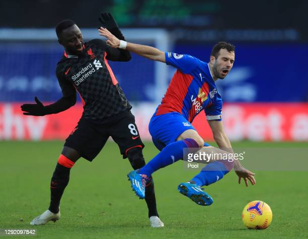 Luka Milivojevic of Crystal Palace is tackled by Naby Keita of Liverpool during the Premier League match between Crystal Palace and Liverpool at...
