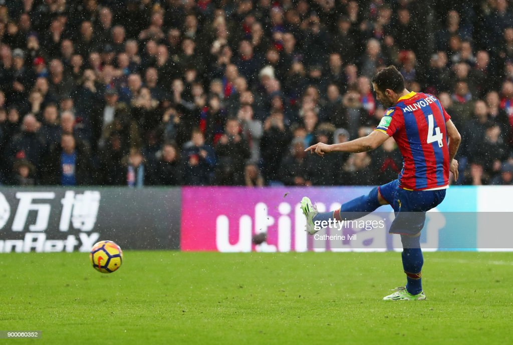 Luka Milivojevic of Crystal Palace misses a penalty as it is saved by Ederson of Manchester City during the Premier League match between Crystal Palace and Manchester City at Selhurst Park on December 31, 2017 in London, England.