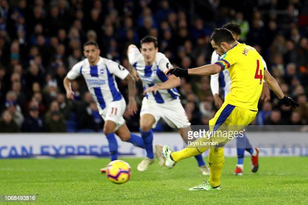 Luka Milivojevic of Crystal Palace scores a penalty for his team's first goal during the Premier League match between Brighton Hove Albion and...