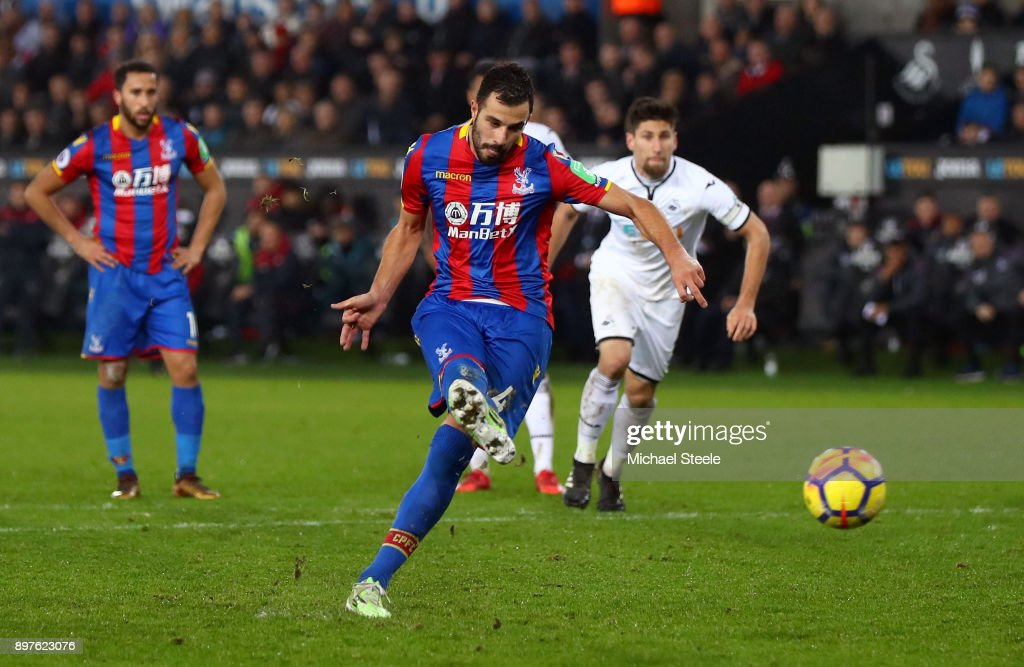 Luka Milivojevic of Crystal Palace scores his sides first goal from the penalty spot during the Premier League match between Swansea City and Crystal Palace at Liberty Stadium on December 23, 2017 in Swansea, Wales.