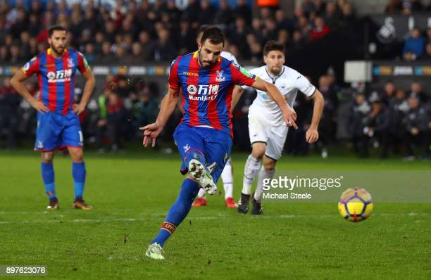 Luka Milivojevic of Crystal Palace scores his sides first goal from the penalty spot during the Premier League match between Swansea City and Crystal...