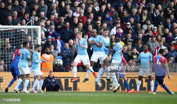 Luka Milivojevic of Crystal Palace scores his team's first goal from a free kick during the Premier League match between Crystal Palace and...