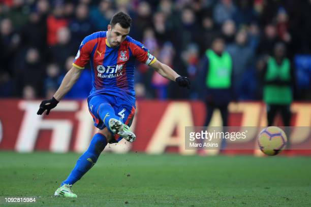 Luka Milivojevic of Crystal Palace scores his team's first goal from the penalty spot during the Premier League match between Crystal Palace and...