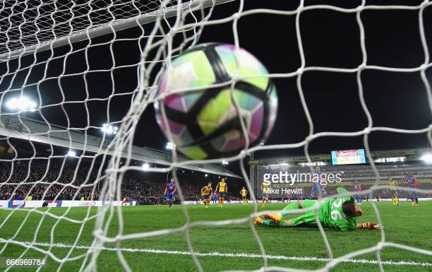 Luka Milivojevic of Crystal Palace scores their third goal from a penalty past goalkeeper Emiliano Martinez of Arsenal during the Premier League...