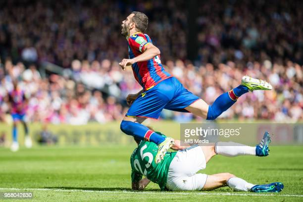 Luka Milivojevic of Crystal Palace tackled by Craig Dawson of WBA during the Premier League match between Crystal Palace and West Bromwich Albion at...