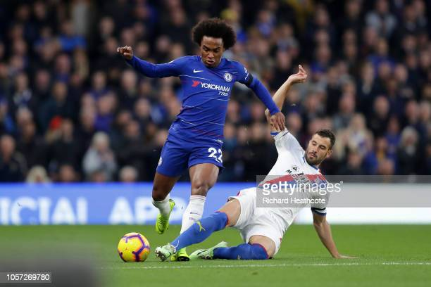 Luka Milivojevic of Crystal Palace tackles Willian of Chelsea during the Premier League match between Chelsea FC and Crystal Palace at Stamford...