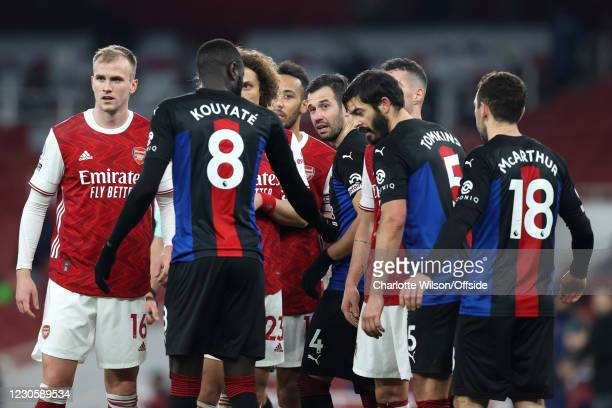 Luka Milivojevic of Palace looks out from the crowd of players gathering for a corner during the Premier League match between Arsenal and Crystal...