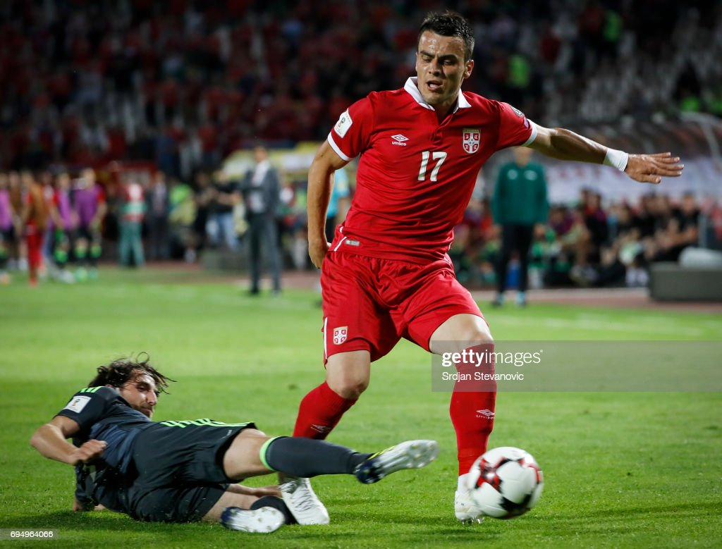 Luka Milivojevic of Serbia is challenged by Joe Allen (L) of Wales during the FIFA 2018 World Cup Qualifier between Serbia and Wales at stadium Rajko Mitic on June 11, 2017 in Belgrade, Serbia.