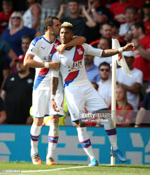 Luka Milivokevic kisses winning goal scorer Patrick van Aanholt of Palace during the Premier League match between Manchester United and Crystal...