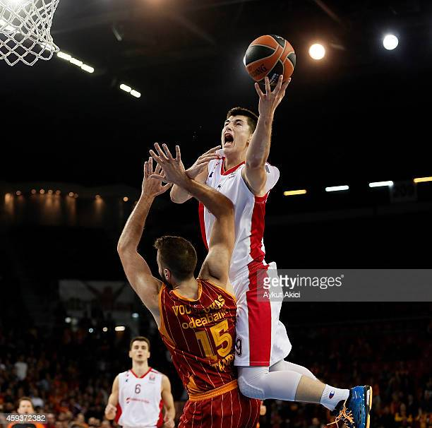 Luka Mitrovic #9 of Crvena Zvezda Telekom Belgrade competes with Ian Vougiouskas #15 of Galatasaray Liv Hospital Istanbul in action during the...