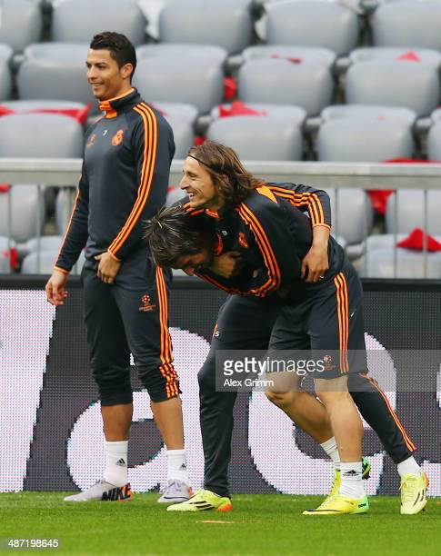 Luka Modric 8front fights with team mate Fabio Coentrao during the Real Madrid training session ahead of their UEFA Champions League semifinal second...