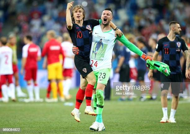 Luka Modric and Danijel Subasic of Croatia celebrate their victory following the 2018 FIFA World Cup Russia Round of 16 match between Croatia and...