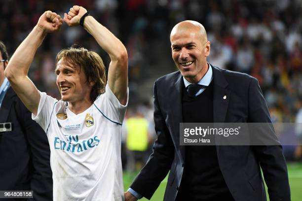 Luka Modric and head coach Zinedine Zidane of Real Madrid celebrate after the UEFA Champions League final between Real Madrid and Liverpool at NSC...