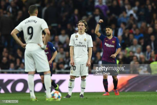 Luka Modric and Karim Benzema of Real Madrid react as Luis Suarez of FC Barcelona celebrates his team's third goal during the Copa del Rey Semi Final...