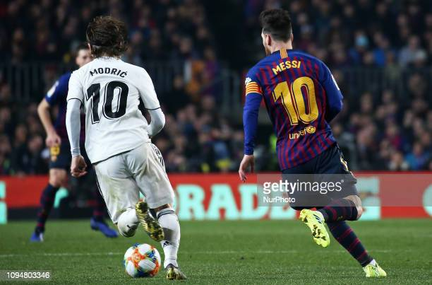 Luka Modric and Leo Messi during the match between FC Barcelona and Real Madrid corresponding to the first leg of the 1/2 final of the spanish cup...