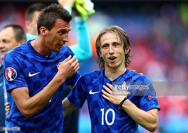 Luka Modric and Mario Mandzukic of Croatia celebrate their team's 10 win in the UEFA EURO 2016 Group D match between Turkey and Croatia at Parc des...