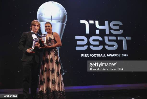 Luka Modric and Marta pose for a photo with their awards during The Best FIFA Football Awards at Royal Festival Hall on September 24, 2018 in London,...