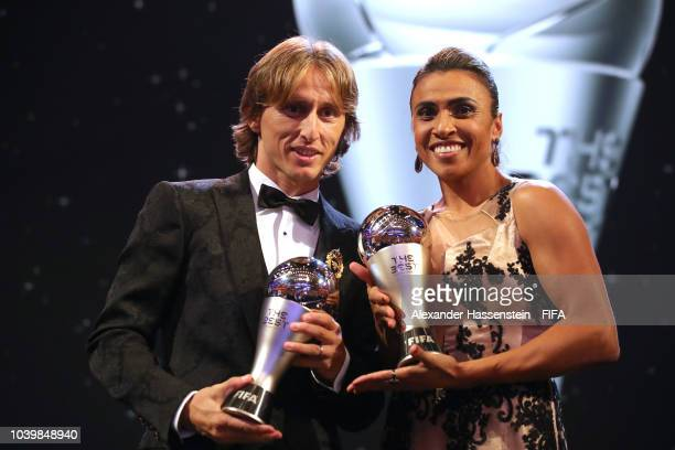 Luka Modric and Marta pose for a photo with their awards during The Best FIFA Football Awards at Royal Festival Hall on September 24 2018 in London...