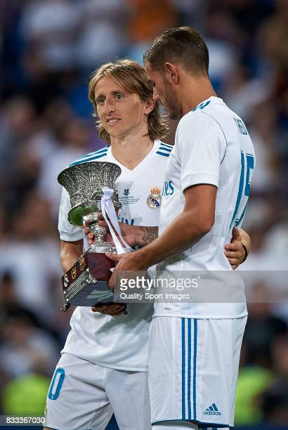Luka Modric and Theo Hernandez of Real Madrid celebrates with the trophy after winning the Supercopa de Espana Supercopa Final 2nd Leg match between...